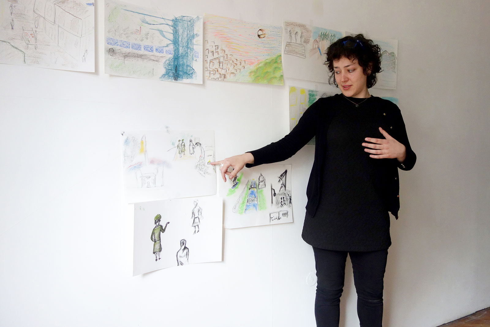 Participant presenting her drawings and imaginations